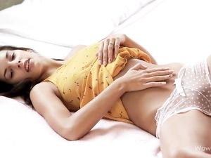 Stripping Beauty In Bed Wears Sheer Panties