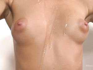 Teen With A Cup Titties Pours Oil Over Her Body